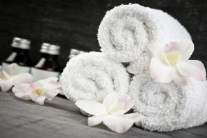 Rolled up towels and products at spa