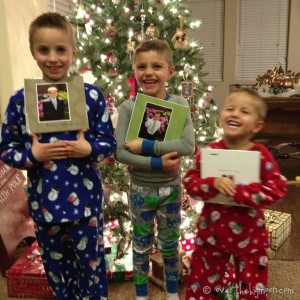 3 little boys wearing pajamas in front of Christmas tree