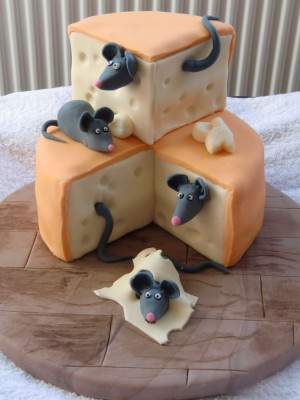 block of cheese with mice cake