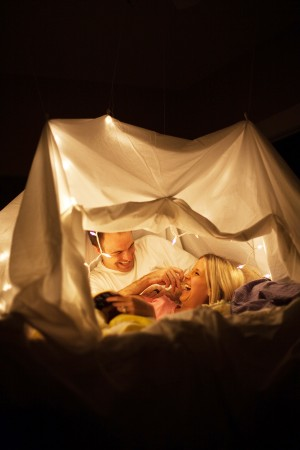 stay at home date night ideas image of a couple in a fort