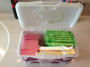 using a baby wipe container to organize bathroom
