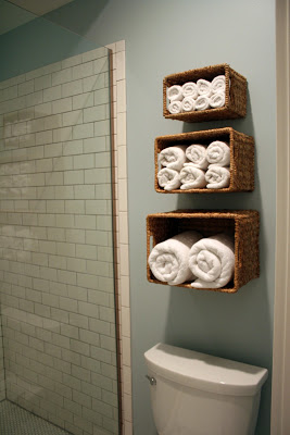 Using baskets for wall storage in bathroom