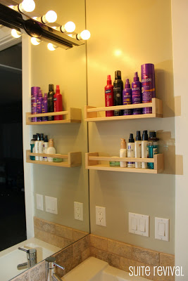 using spice racks to organize bathroom