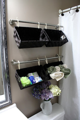 hanging baskets on bathroom wall
