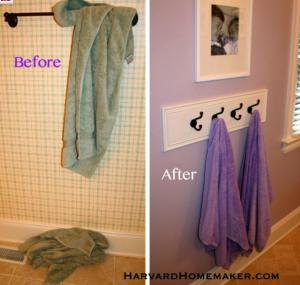 using coat hooks to hang towels in bathroom