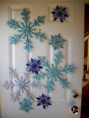Painted dollar store snowflakes on door