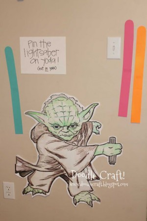 pin the lightsaber on yoda