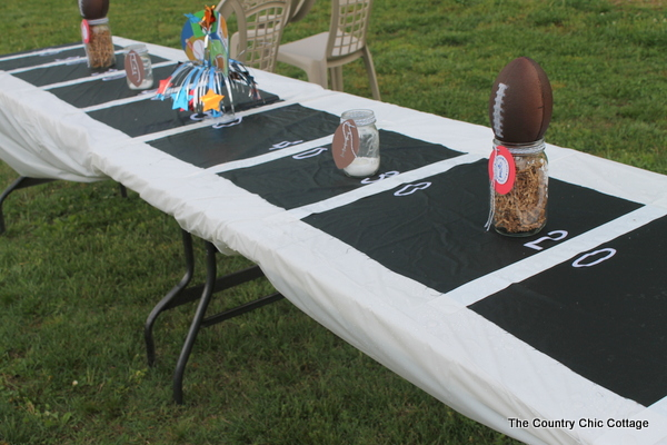 long table decorated with football theme for teen birthday party