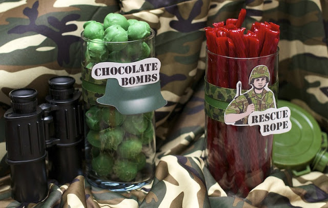 containers of chocolates and licorice ropes for army themed teen party