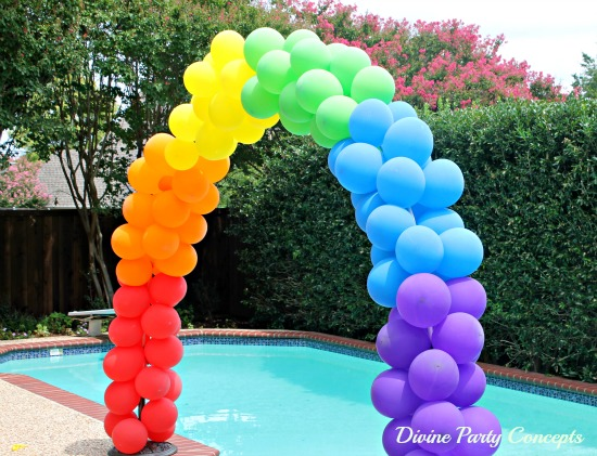 rainbow colored balloon arch for sweet 16 parties