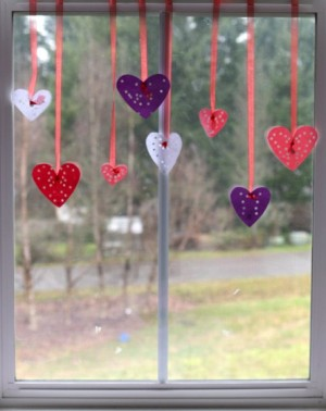 hole-punch-hearts-in-window--455x573