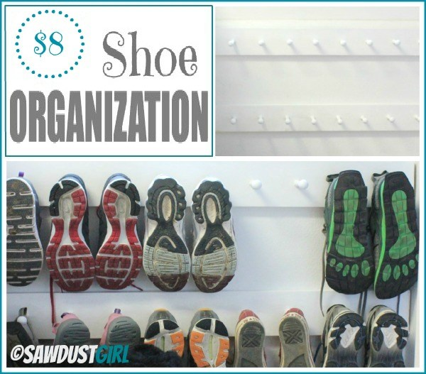 pegs mounted on wall for shoe organization