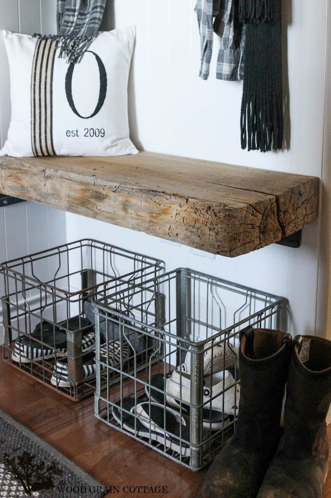 milk crates used as shoe storage in entryway