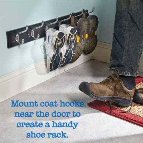 coat hooks mounted on wall near floor to hold shoes