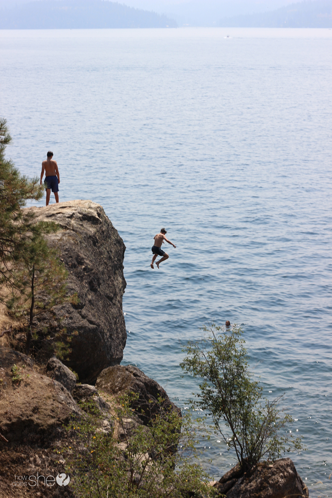 jumping off boulders into lake
