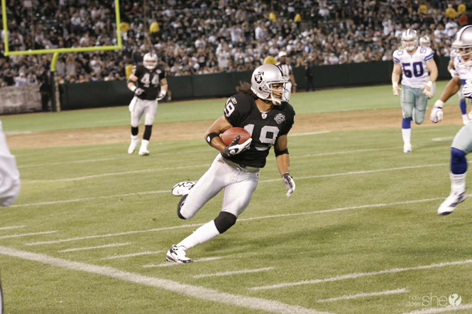 An Oakland Raider running the ball