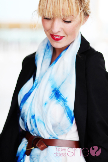 woman wearing red lipstick and blue and with dress with black blazer