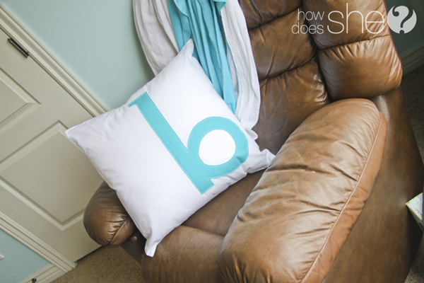 monogrammed pillow cover on a pillow on a rocking chair