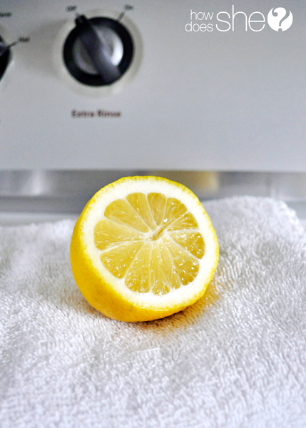 a lemon on a towel on a washing machine