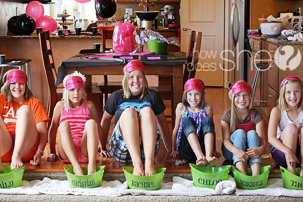 6 tween girls with feet soaking in buckets